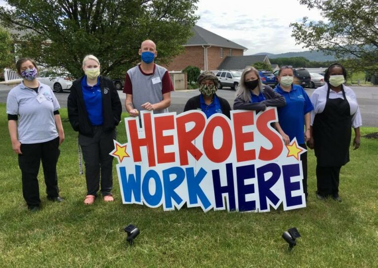 "Shenandoah Senior Living | Associates with ""Heroes Work Here"" Sign"
