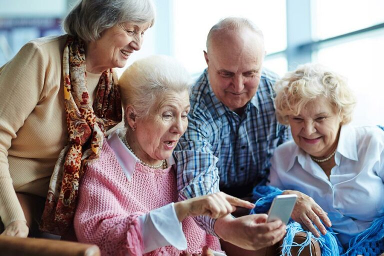 Shenandoah Senior Living | Seniors looking at smartphone